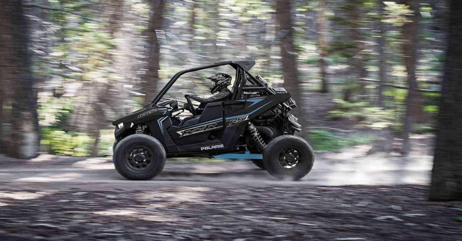 Polaris RZR RS1 driving fast in the forrest