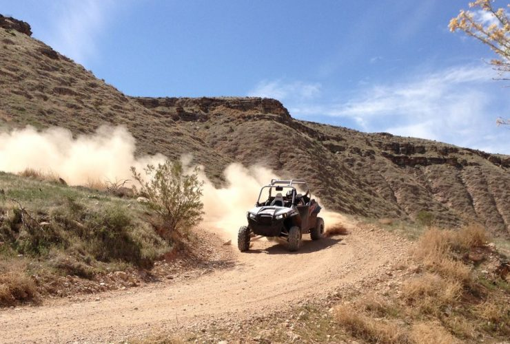 UTV driving fast on dirt road