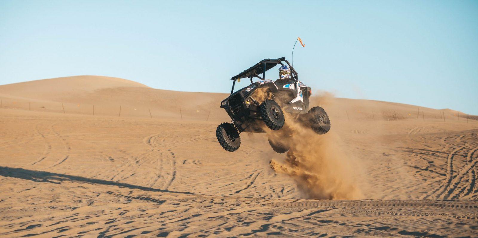 UTV jumping in desert