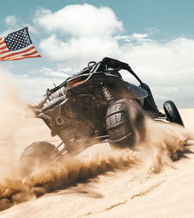 UTV with paddle sand tires and USA flag